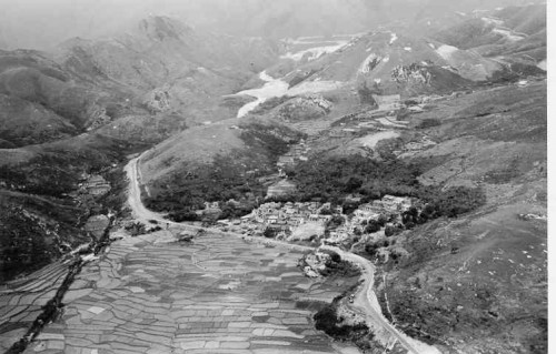 Shui Hau Village with its fields, and showing the South Lantau Road going through to the Shek Pik Reservoir site, both then under construction, 1959-60.
