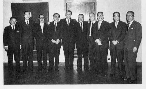 Shanghai spinners in the mid 1950s with the Chairman of the HSBC From left: Mr. Vincent Woo (Central Textiles), Mr. H. C. Yung (???, Nanyang), Mr. C. S. Loh (???, Wyler), Mr. T. Y. Wong (???, Hong Kong Spinners), Sir Michael Turner, Mr. C. C. Lee (???, South China), Mr. Mou Lee (??, Kowloon), Mr. Y. C. Wang (???, Nanyang), Mr. Z. D. Woo (???, Hong Kong Spinners) and Mr. T. Y. Tung (???, South China). Source: 40 Years of the Hong Kong Spinning Industry, p. 58.