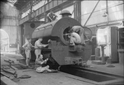 Royal Air Force personnel work to repair an engine for the Kowloon Railway, Hong Kong. This railway was immobilised during the Japanese occupation, services were restored under Royal Air Force supervision after the liberation. (photographs) Made by: Royal Air Force official photographer