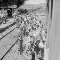 Japanese soldiers who were rounded up in the Fan Ling district of Hong Kong by men of the 3rd Commando Brigade are put aboard a train bound for Kowloon . photographs) Made by: No 9 Army Film & Photographic Unit