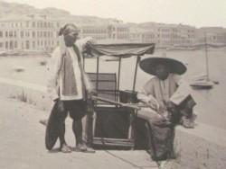 A sedan chair with two bearers