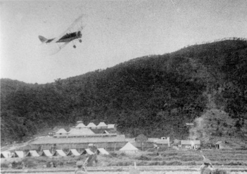 Kwanti Racecourse 3 IDJ February 1937-note volunteers at bottom trying to shoot aircraft