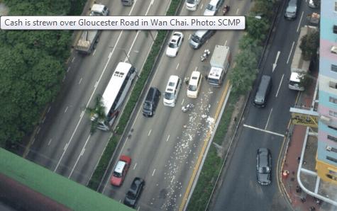 Cash strewn in Wanchai SCMP pix 24.12.14