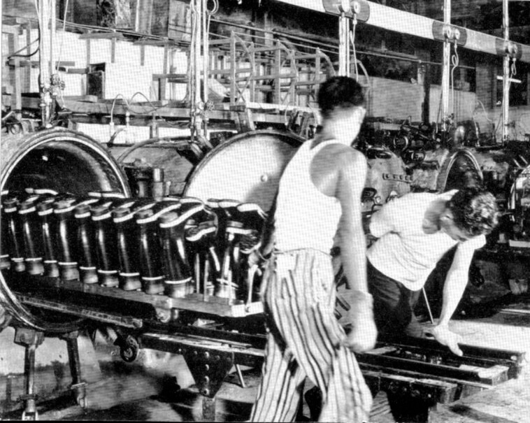 Rubber Hong Kong-Wellington boots being cured in an oven Location.date unknown